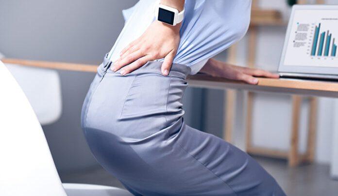 Болі в спині в області попереку: причини, що робити